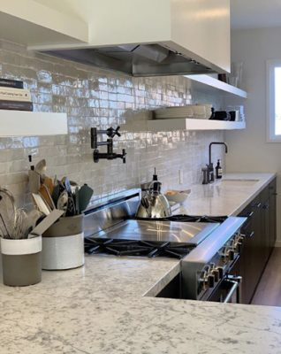 8 Incredible Kitchen Designs That Incorporate Wall Mounted Pot Fillers Image 5